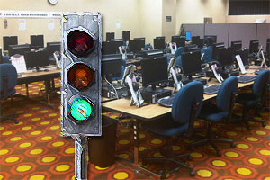 A green light traffic signal imposed in front of an empty computer lab.