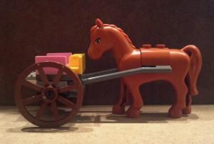 Lego horse facing lego cart