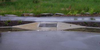 A curb cut with inset bumpy plastic pad