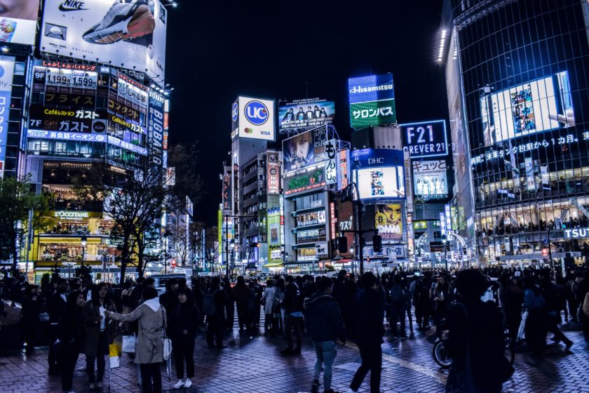 Tokyo's famous Shibuya crossing lit up with ads at night