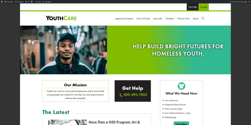 "The home page of YouthCare.org shows dark ""bars"" on each side of the screen at wide widths"