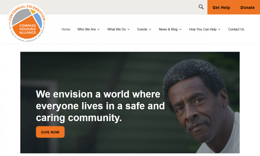 "Compass Housing Alliance Home page with large banner of man facing camera and words ""We envision a world where everyone lives in a safe and caring community."""